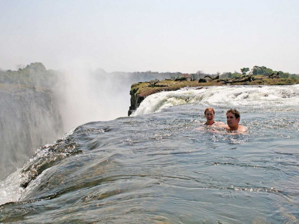 6607610-swim-at-the-edge-of-a-cliff-at-the-devils-pool-a-natural-infinity-pool-in-victoria-falls-which-borders-zambia-and-zimbabwe-1473254537-1000-a3a901cb23-1481527505